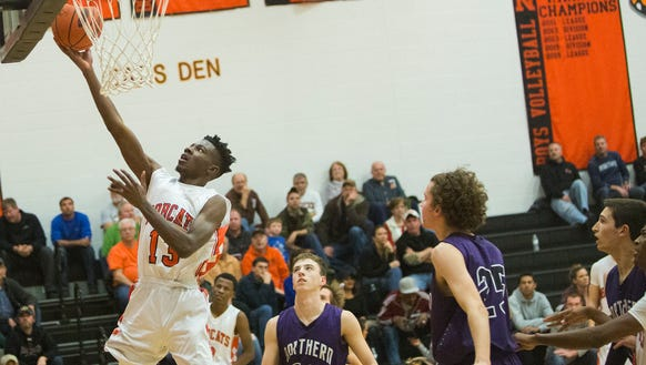 Kobi Nwandu leads a balanced Northeastern scoring attack.