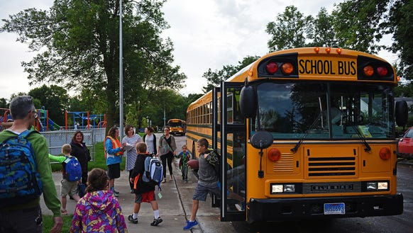 Children get off of a bus at the new Sonia Sotomayor