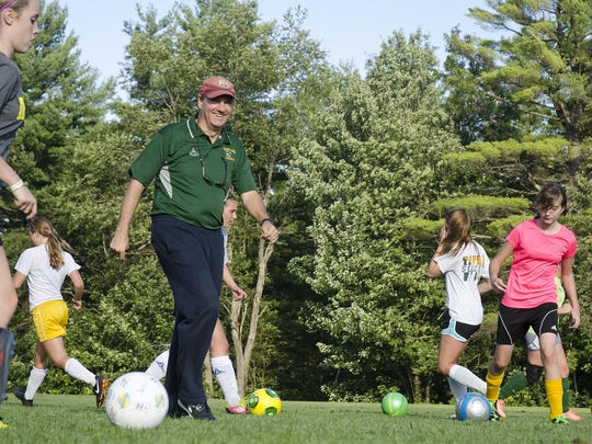 Coach Jim Eisenhardt (second from left) led Peoples Academy to its third straight Division III girls title.