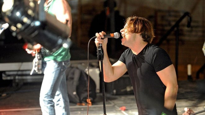 Miyagi lead singer Nolan Cannedy performs at Downtown Wichita Falls Development's St. Patrick's Day Street Festival in 2014. Catch the band in concert Jan. 7 at the Iron Horse Pub.