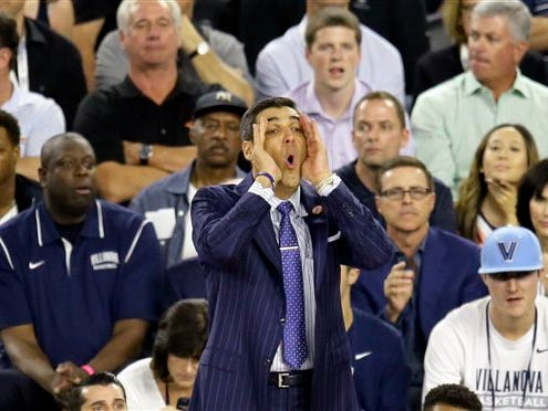 Villanova head coach Jay Wright directs his team during the first half of the NCAA Final Four tournament college basketball championship game against North Carolina, Monday, April 4, 2016, in Houston.