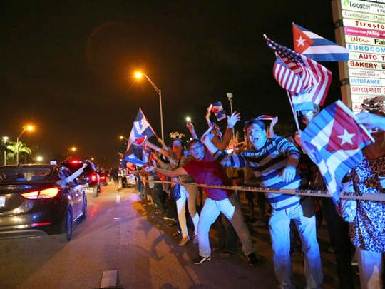 The Cuban community in Miami celebrates the announcement that Fidel Castro died in front of La Carreta Restaurant, early Saturday, Nov. 26, 2016, in Miami. Within half an hour of the Cuban government's official announcement that former President Fidel Castro had died, Friday, Nov. 25, 2016, at age 90, Miami's Little Havana teemed with life - and cheers.