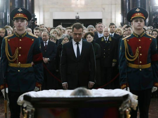 Russian Prime Minister Dmitry Medvedev, center, attends a farewell ceremony for the Russian Ambassador to Turkey Andrei Karlov at the Foreign Ministry headquarters in Moscow, Russia, Thursday, Dec. 22, 2016. Karlov was fatally shot by a Turkish policeman Monday in a gathering in Ankara, Turkey.
