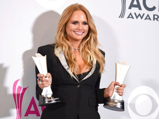 """Miranda Lambert poses in the press room with her awards for album of the year for """"The Weight of These Wings,"""" and female vocalist of the year at the 52nd annual Academy of Country Music Awards at the T-Mobile Arena on Sunday, April 2, 2017, in Las Vegas."""