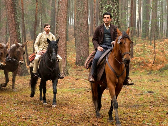 "This image released by Open Road Films shows Christian Bale, left, and Oscar Isaac in a scene from ""The Promise."""