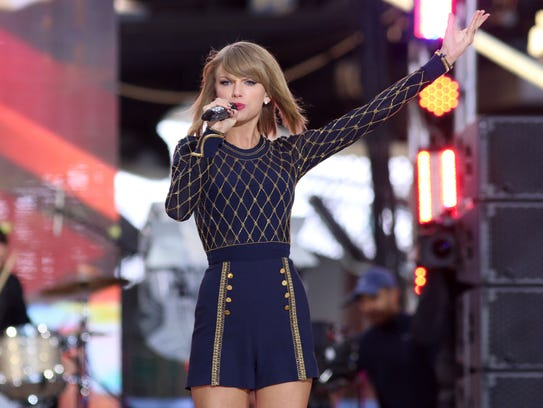 In this Oct. 30, 2014 file photo, Taylor Swift performs