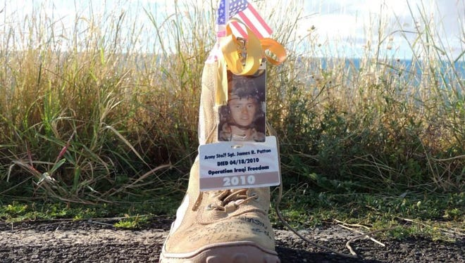 A boot memorializing U.S. Army Ranger Staff Sgt. James Patton, decorated by his mother, Sheila Ryder Patton as part of a display of over 7,000 boots set up at Fort Campbell in late October 2014.