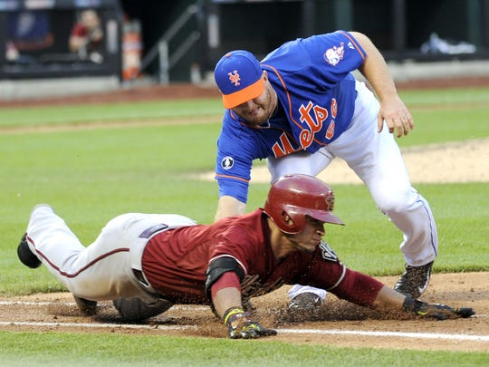 New York Mets relief pitcher Josh Edgin tags out Arizona Diamondbacks' Gerardo Parra during a game in 2014. Edgin is a Mercersburg Academy graduate and was recently put back on the Mets' roster after rehabbing from Tommy John surgery.