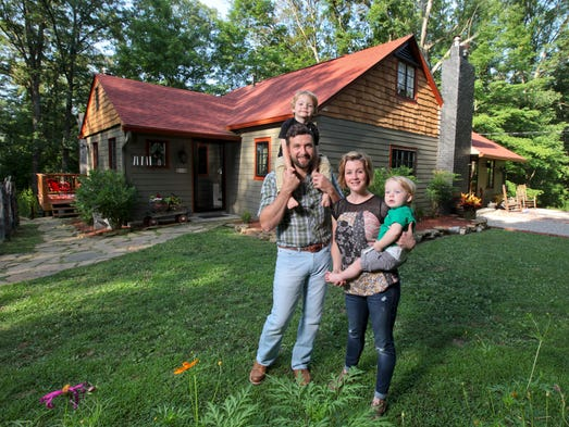Homeowners Eddie and Kristin Kidwell with their two children Wyatt and Hollis at their home in New Albany. July 7, 2014
