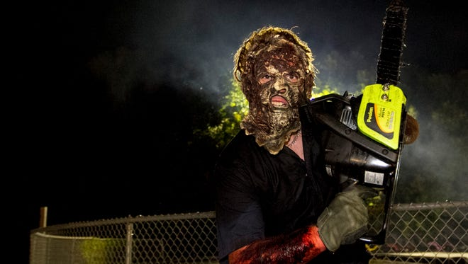 Masked men with chainsaws chase people at the end of the Haunted Hike at Mike's Greenwell's in Cape Coral.