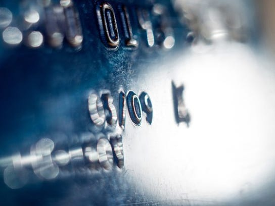 Close-up of a credit card showing a partial number and expiration date.