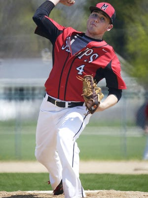 Manitowoc Lincoln's David LaTour (4) winds out a pitch to Sheboygan North May 7 at the Field of Dreams in Sheboygan.