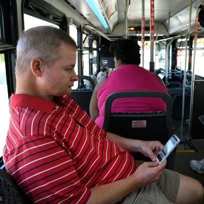 Joe Linzer rides the 11-Kingston Pike bus Wednesday,