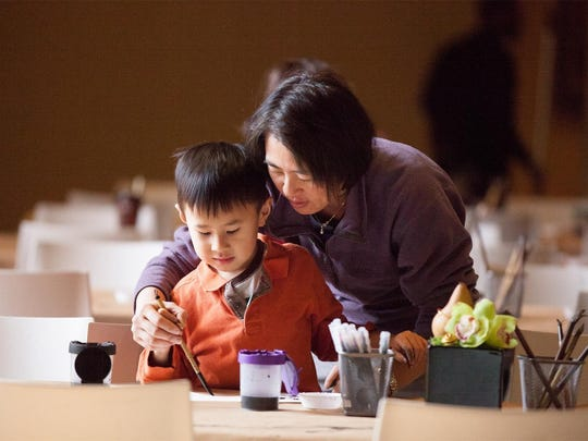 A mom and son work together on a Chinese New Year craft at the Philadelphia Museum of Art.