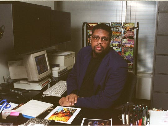 The late comic book artist/creator Dwayne McDuffie in his New York office in 1996.