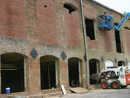 Contract workers work on the historic Apalache Mill,