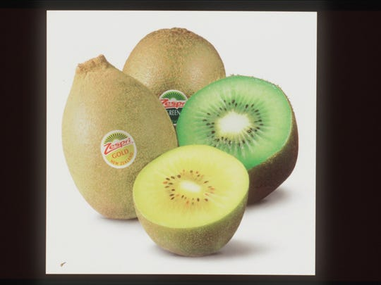 Green and gold kiwi fruits 