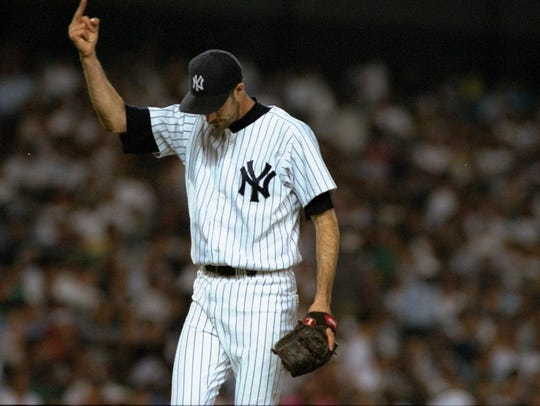 New York Yankees pitcher Jack McDowell gives fans the