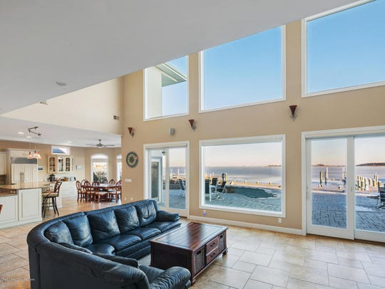 The home has an open floor plan with massive windows the provides natural lighting in the entire home.