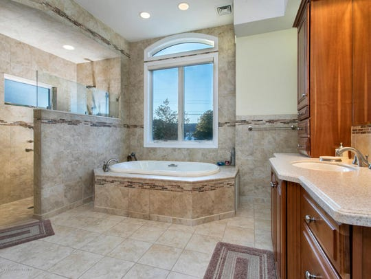The master bathroom features a Jacuzzi tub and walk-in