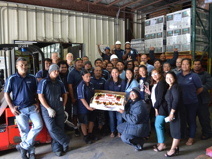 Employees at Triple J Five Star Wholesale Foods were