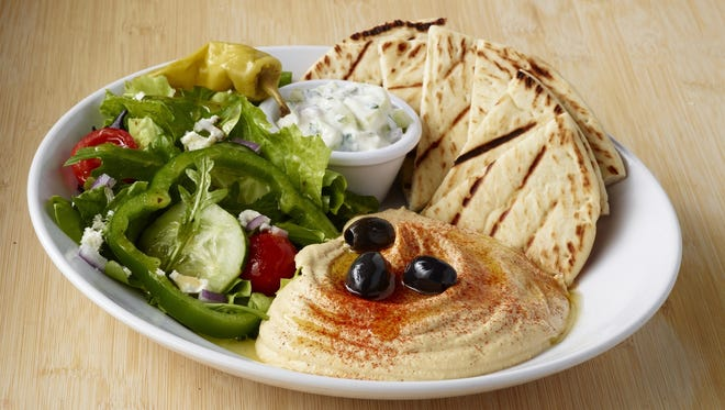 Zoe's Kitchen offers this pita platter with salad and pita.