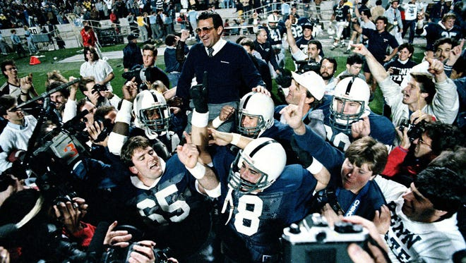 FILE - In this Jan. 2, 1987, file photo, Penn State coach Joe Paterno is carried off the field after the Nittany Lions defeated Miami 14-10 in the Fiesta Bowl in Tempe, Ariz., to win the national championship.
