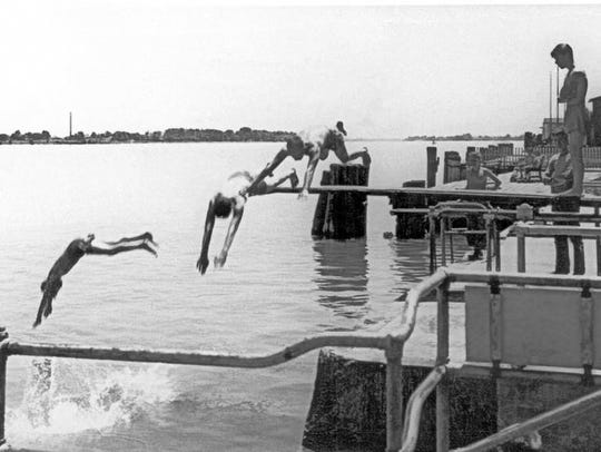 Kids dive into the St. Clair River at the Palmer Park