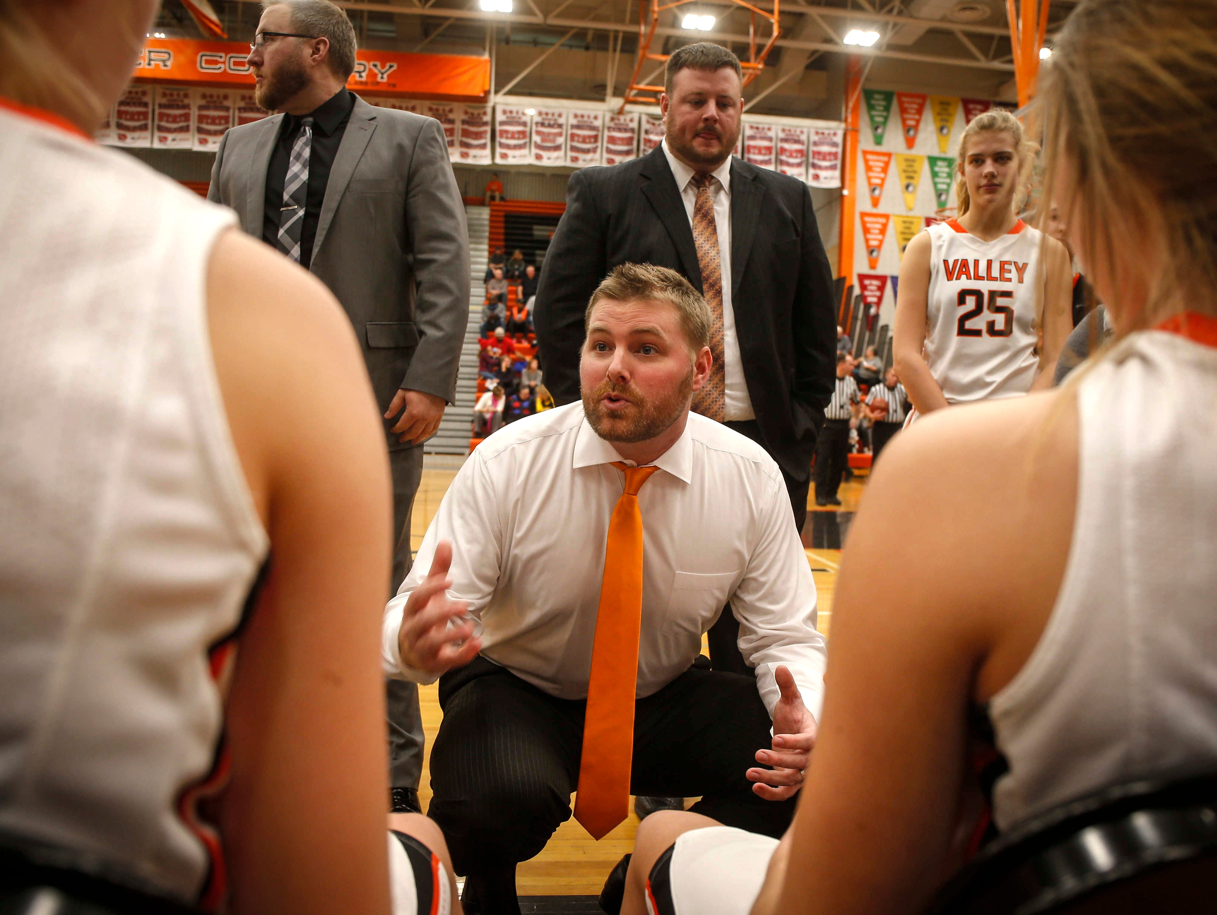 Valley girls basketball coach Joe Sigrist talks to his team during a timeout against Dowling Catholic on Tuesday, Jan. 10, 2017, at Valley High School in West Des Moines.