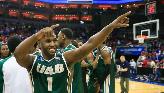 UAB's Denzell Watts celebrates after the Blazers stunned the No. 3-seed Cyclones 60-59 Thursday afternoon at the Louisville Regional. By Matt Stone, The Courier-Journal