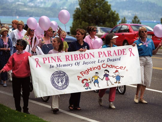 Members from the South Lake Tahoe community marched in 2001 along Highway 50 Sunday during a pink ribbon parade to remember Jaycee Lee Dugard, who was abducted 10 years ago.