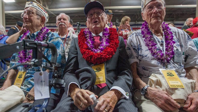 Milton Mapou, left, of the USS Detroit, Donald Stratton, center, of the USS Arizona, and Thomas Berg, right, of the USS Tennessee wait for the start of the opening ceremony for the 75th anniversary of the Japanese attack on Pearl Harbor on Kilo Pier at Joint Base Pearl Harbor-Hickam, Wednesday, Dec. 7, 2016, in Honolulu.