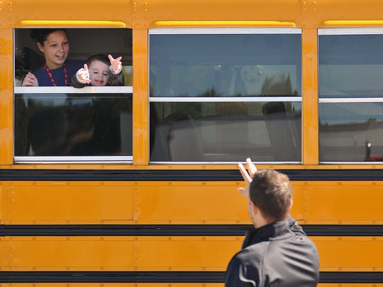 TJ Mion, 2, of Ontario, waves to his dad, Timothy,