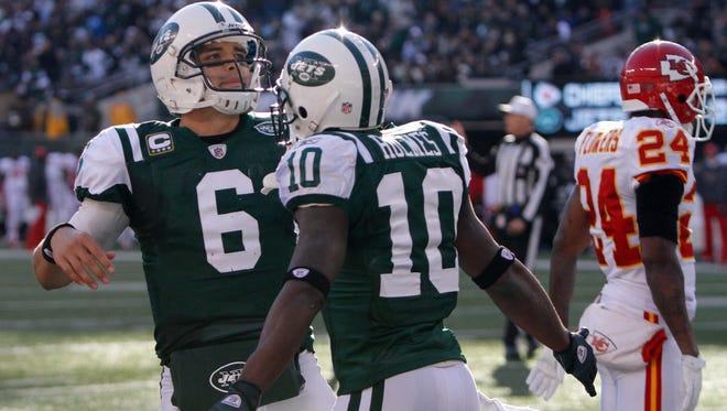 Might former Jets mainstays Mark Sanchez (6) and Santonio Holmes be cap casualties?