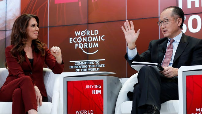 Jim Yong Kim, President World Bank, right, speaks to moderator Susanne Wille, during a panel session during the 48th annual meeting of the World Economic Forum, WEF, in Davos, Switzerland, Wednesday.