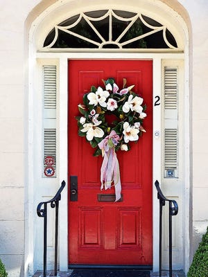 Update your front door decor for spring with craft items or silk flowers you may already have around the house.