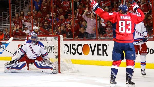 Washington Capitals center Jay Beagle (83) celebrates after scoring a goal on Rangers goalie Henrik Lundqvist (30) in the second period in Game 3 of the second round of the 2015 Stanley Cup Playoffs at Verizon Center.