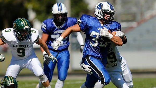 St. Mary's Springs Academy football's Clay Schueffner runs the ball against Laconia High School at Fruth Field in Fond du Lac on Saturday, Sept. 30, 2017. Springs won the matchup 55-6.