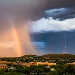Lightning, downpour and a rainbow -- what monsoon season is all about -- wrapped up in an Aug 24, 2015, sunset in the Catalina Foothills of Tucson.The photo was submitted to USA TODAY via Your Take at yourtake.usatoday.com.