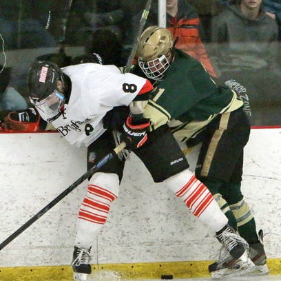 Zach Vitkuske and Howells Brendan Adams battle for