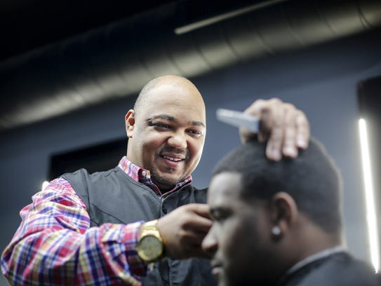 haircut at his barber shop Universal Kutz barbershop in Des Moines ...