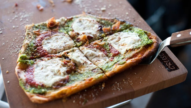 Crust's The God Mother features ricotta pesto, bacon, fresh mozzarella and a touch of pizza sauce.