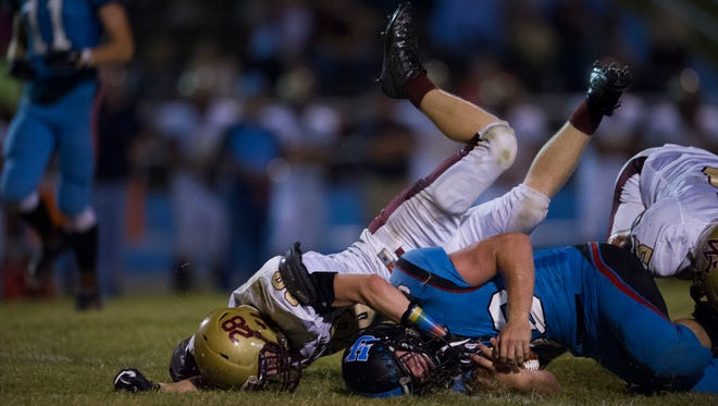Webster County's Peyton Yates (28) makes the tackle against Union County's Avery Buckman (30) as he moves the football down the field at Friday night's game.
