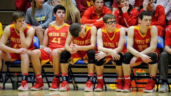 Members of the Mater Dei bench appear dejected during their game against Castle in the first round of the SIAC Tournament at Castle High School in Newburgh, Tuesday, Jan. 10. 2017. Castle beat Mater Dei 78-41.