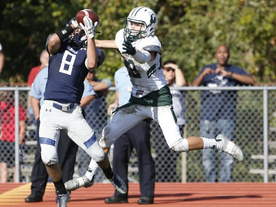Jon Leverock (8) of Mater Dei intercepts a pass in front of Delbarton defender during game at Mater Dei Prep High School, Middletown,NJ. Saturday, October 28, 2017.  Noah K. Murray-Correspondent Asbury Park Press