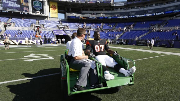 Cincinnati Bengals defensive tackle Geno Atkins (97) is carted off the field after their game against the Baltimore Ravens in Baltimore.