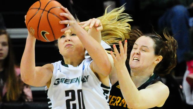 University of Wisconsin-Green Bay freshman Jessica Lindstrom grabs a rebound in front of Vermont's Jordan Eisler during the first half of Saturday's game at the Kress Events Center.