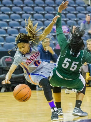 UE's Camary Williams (0) collides with Cleveland State's Khayla Livingston (55) in the first quarter at Ford Center in Evansville, Ind. Saturday afternoon, Nov. 12, 2016.