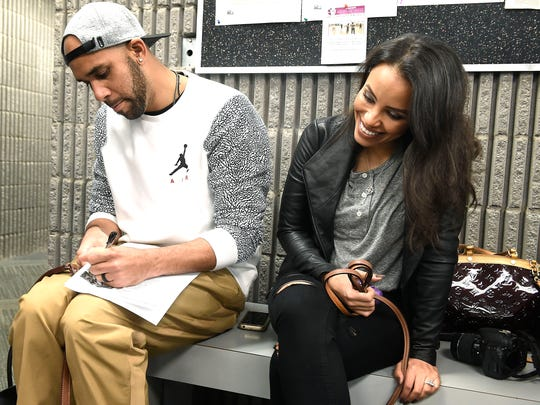 David Price, a Murfreesboro native, signs an autograph for a fan as he sits with his wife, Tiffany, on Monday, Jan. 23, 2017. They are expecting their first child in May.
