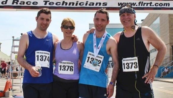 The Schneiders enjoy running with their sons.
